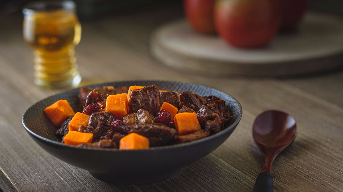 The perfect stew for autumn and fall, this beef stew recipe uses a roast, sweet potatoes and cranberries.